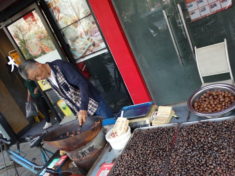 продавец жареных орехов,Китай